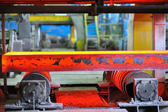 Hot steel on conveyor Royalty Free Stock Photos
