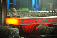 Hot steel on conveyor Royalty Free Stock Photography