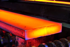 Hot steel on conveyor. Shoot inside of plant Royalty Free Stock Images