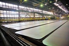 Hot steel on conveyor Stock Photos