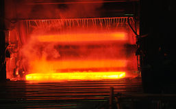 Hot steel on conveyor Royalty Free Stock Photo