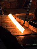 Hot steel on conveyor Royalty Free Stock Image