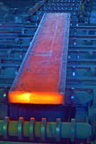 Hot steel on conveyor Stock Image