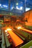 Hot steel on conveyor Royalty Free Stock Photos