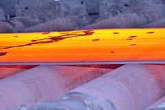 Hot steel on conveyor Royalty Free Stock Image