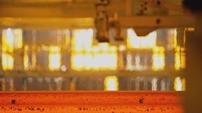 Hot steel on conveyor stock video footage