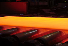 Hot steel on conveyor Stock Images