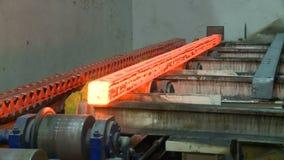 Hot steel ingots on conveyor. Foundry casting process stock footage