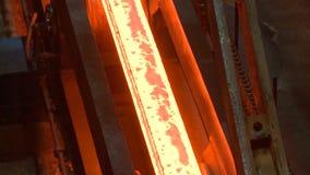 Hot steel ingots on conveyor. Foundry casting process stock video footage