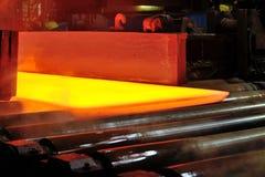 Hot steel plate on conveyor Royalty Free Stock Image