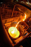 Hot steel pouring in steel plant Stock Photography