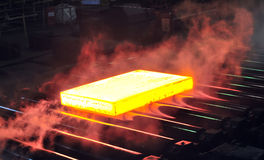 Hot steel sheet on conveyor Royalty Free Stock Photo