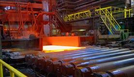 Hot steel sheet on conveyor Stock Photography