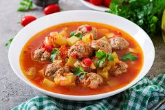 Hot stew tomato soup with meatballs and vegetables. Closeup in a bowl on the table. Albondigas soup, spanish and mexican food stock photos