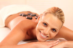 Hot Stone. Beautiful blond woman enjoying some hot stones stock photography