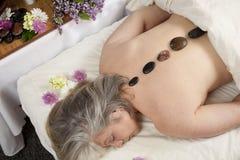 Hot stone masage stock photos