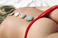 Hot stone massage Royalty Free Stock Images