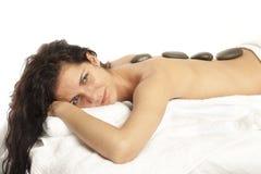 Hot stone massage Stock Image