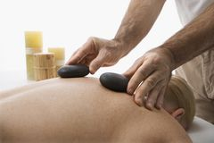 Hot stone massage. Royalty Free Stock Images