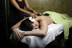 Hot stone massage Stock Photo