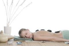 Hot stone massage Stock Photos