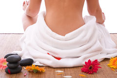 Hot stone massage. Concept with a beautiful woman royalty free stock photo