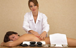 Hot stone massage Stock Image
