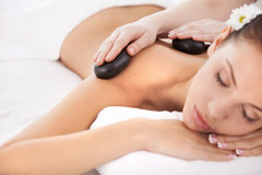 Hot stone massage. Royalty Free Stock Photography