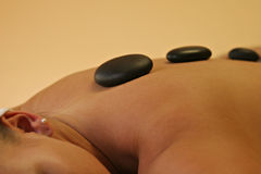 Hot stone massage closeup Stock Image