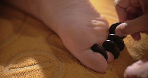 Hot Stone Massage of Foot stock video footage