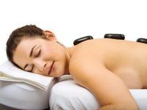 Hot stone massage happiness Royalty Free Stock Photo