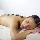 Hot Stone Massage In The Day Spa Royalty Free Stock Photo