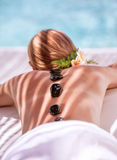 Hot stone massage Stock Images