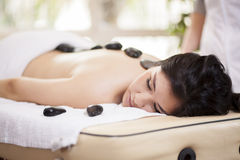 Hot stone massage at a spa Royalty Free Stock Image