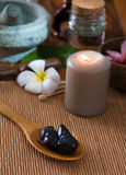 Hot stone massage with spa treatment items on the background Royalty Free Stock Images