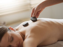 Hot stone massage at spa Stock Photos