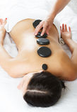 Hot stone massage therapy. Alternative Therapy - Hot stone massage therapy Royalty Free Stock Images