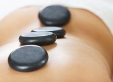 Hot stone massage therapy. Alternative Therapy - Hot stone massage therapy Stock Photos