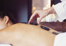 Hot stone massage therapy. Spa treatment Royalty Free Stock Photos