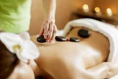 Hot stone massage therapy royalty free stock image