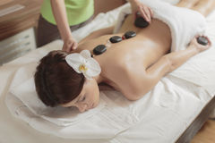 Hot stone massage therapy Stock Image