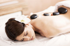 Hot stone massage therapy Stock Photos