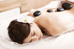 Hot stone massage therapy Royalty Free Stock Photo