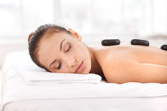 Hot stone therapy. Royalty Free Stock Photo