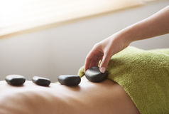 Hot stone therapy Royalty Free Stock Image