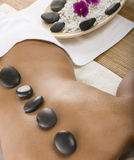 Hot stone treatment Stock Photos