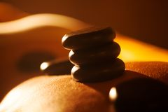 Hot stone treatment in day spa Stock Photos