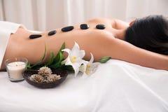 Hot Stone wellness treatment. With decoration royalty free stock photo