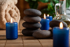 Hot stones essential oil and candles Royalty Free Stock Photo