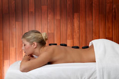Hot stones massage Stock Photo